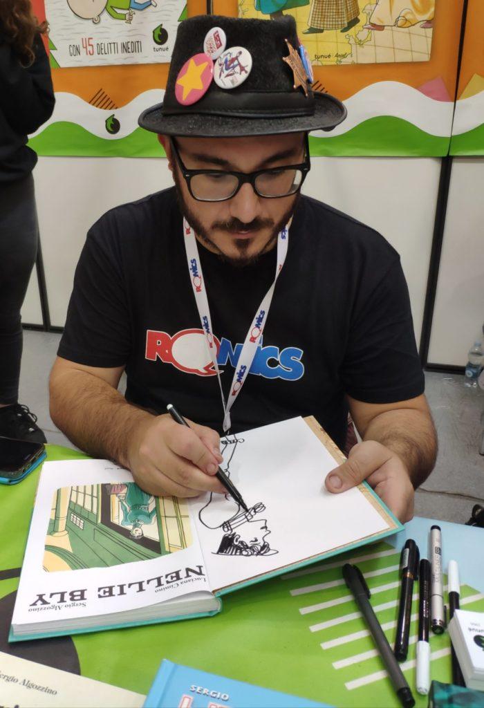 Mio caro fumetto... - Sergio Algozzino al Romics mentre dedica la mia copia di Nellie Bly